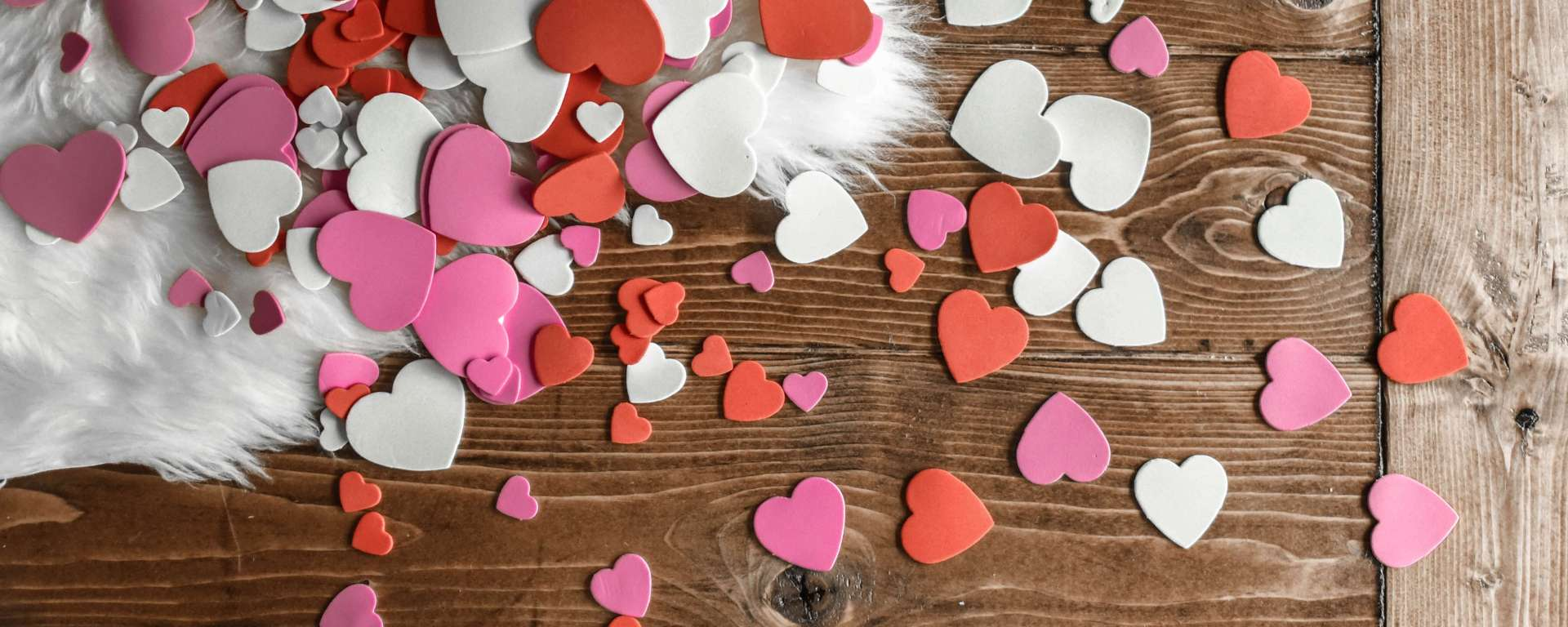 Confetti hearts on the floor and a shag rug